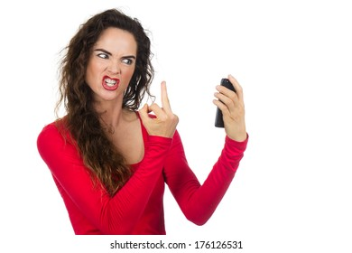 A very angry, annoyed and frustrated woman  giving the finger to the phone in rage. Isolated on white.