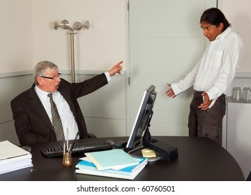 Very angry director firing one of his young employees