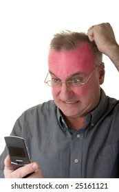 Very angry man with a exaggerated facial expression looking at a cellphone and turning red in the face.