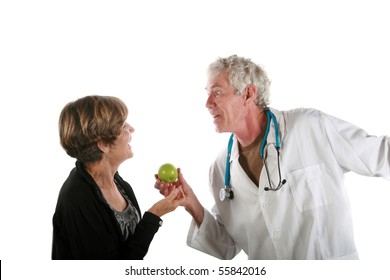 a very animated doctor has a strange look on his face as he prescribes an apple a day to his patient          isolated on white