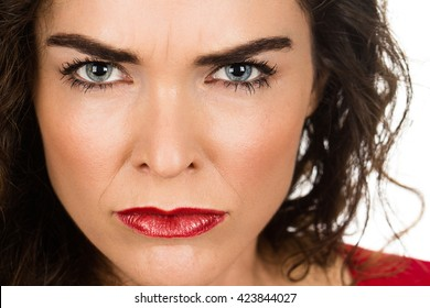 A very annoyed angry and woman. Isolated on white.