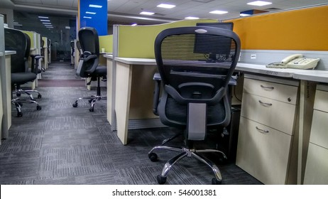 Very attractive empty adjustable reclining office chairs arranged in corporate office during in smart cubicles