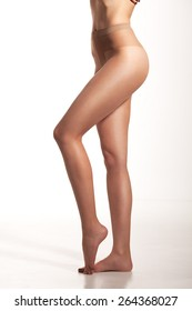 Very attractive woman wearing nothing but a transparent stocking in skin color