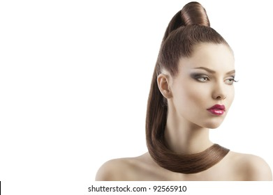 very attractive young brunette with long hair and tail and creative hair style looking luxory and proud, she is turned of three quarters and looks down at left and has a lock of hair around her neck