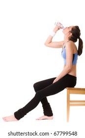 very attractive, young and fit woman drinks mineral water after some exercise, studio shoot isolated on white