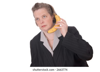 very attractive young woman talking on a mobile banana phone Isolated over white.