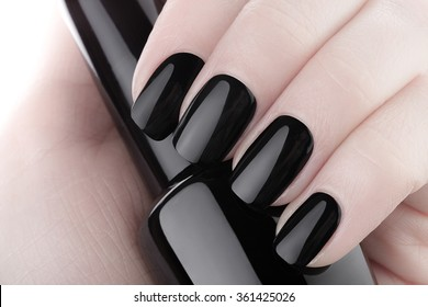 Very beautiful black nails close up.