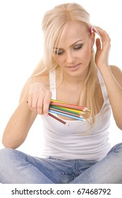 very beautiful blonde with a bunch of colored pencils on white background