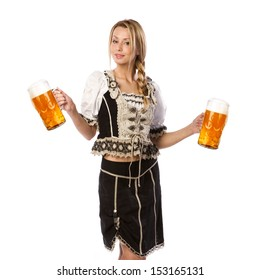 very beautiful caucasian white woman in traditional tiroler costume or outfit is holding a big glass of beer in her hands