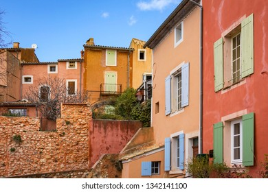 Very beautiful and colorful houses in the small French village of Roussillon, famous for its ochre rocks. France, Provence, Luberon.