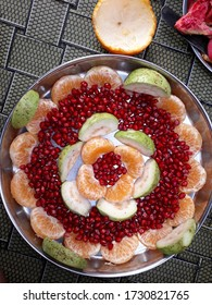 Very beautiful fruit decoration from oranges, guava, pomegrant. And its very attractive and healthy.