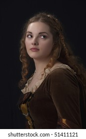 Very beautiful girl in medieval dress in studio look like a old time paynting