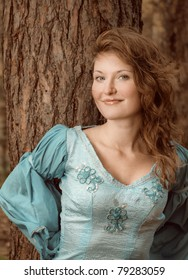 Very beautiful girl in medieval dress in autumn wood