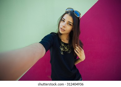 Very beautiful girl student doing selfie for instagram on vacation in Europe