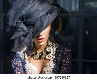 Very beautiful lips of a woman in a black hat