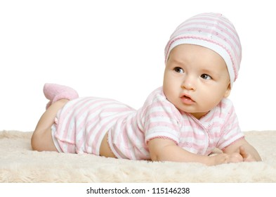 the very  beautiful  little baby  in pink dress, lie on stomach,  on white background, isolated