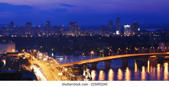 Very beautiful night city with bridge, many colorful lights, Kiev, Ukraine