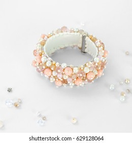 very beautiful pale pink female bracelet-type wedding pearls handmade isolated on white background