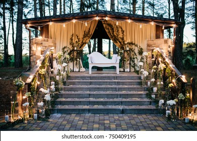Very beautiful and romantic exit ceremony. Live white flowers, light bulbs, steps. Evening ceremony.