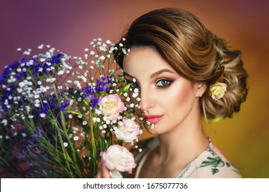Very beautiful spring girl. Model with a bouquet of flowers. Tender girl spring. Gentle makeup. Spring paints.