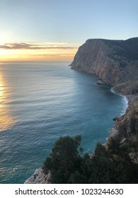 a very beautiful sunset, a sunny path reflected in the sea, around the beautiful cliffs