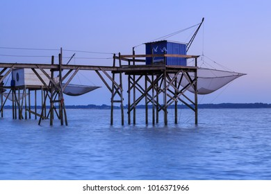 Very beautiful view of fishing huts at sunset over the Atlantic Ocean