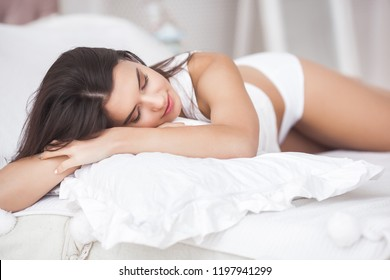 Very beautiful woman in the bed. Portrait of young attractive lady in the bedroom