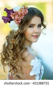 very beautiful young girl Ukrainian in a luxurious dress delicate pink smoke transparent mesh beach town beach on  hair smiling cute beautiful blonde long hair rose bridge river