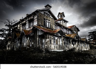 A very big and scary looking abandoned haunted building, house or castle in night