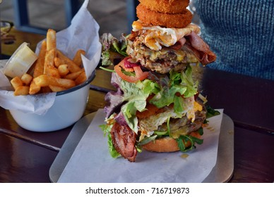 Very big unhealthy Australian hamburger with chips