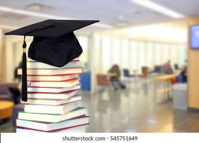 very blurry campus of university background and book for education concept