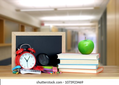 very blurry school hall background and book for education concept