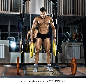 very brawny guy bodybuilder,  execute exercise with  weight
