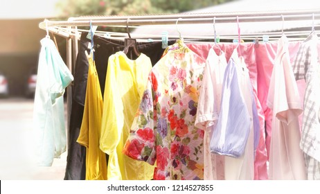 very bright, soft shot of colorful clothes hanging on clothesline to get dried on sunny day
