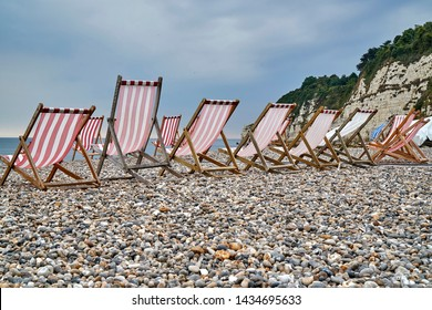 A very British seaside scene - deckchairs on the beach at Beer, Devon