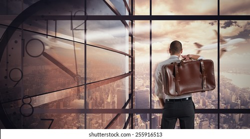 Very busy businessman relaxes looking at view