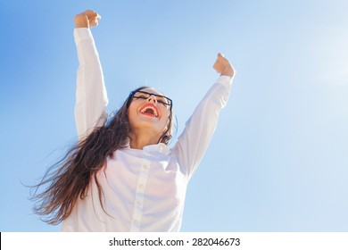 very cheerful business woman celebrating victory