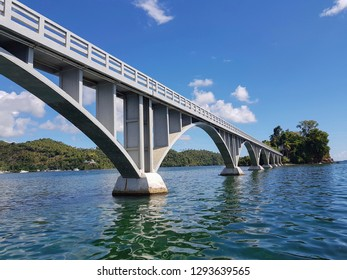 very close to pedestrian white bridge next to santa barbara city in samana island dominican republic, unique construction in atlantic ocean