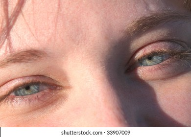 Very close up shot of two beautiful longing wispy blue eyes
