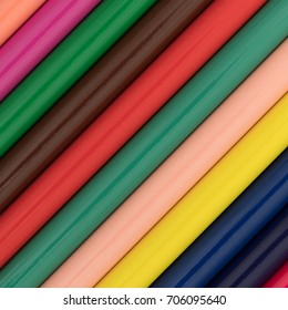 A very close view of colorful pencils at an angle.