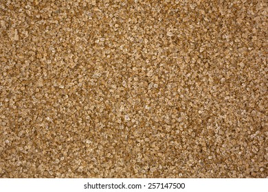 A very close view of granulated sugar with cinnamon spice.