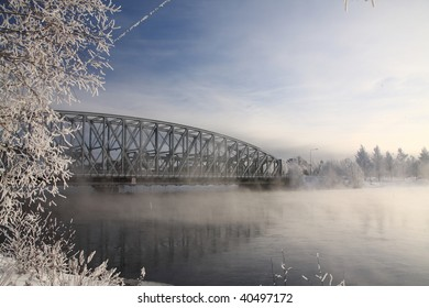 Very cold day, view over a river and bridge