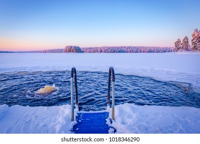 Very cold weather at sunset. Ice swimming place from Kuhmo, Finland.