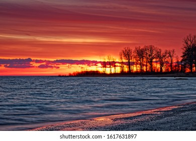 A very colorful December sunset viewed from Waverly Beach in Fort Erie, Ontario, looking southwest over Lake Erie.
