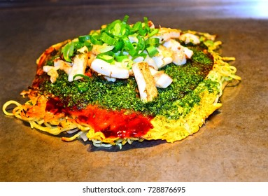 A very colorful Okonomiyaki (Japanese layered pancake) served in a restaurant in Hiroshima, Japan