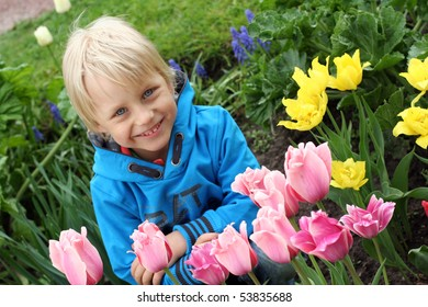 Very cute boy in tulip park in Helsinki