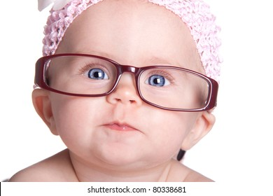 A very cute image of an adorable baby wearing glasses.  This baby is already saving for her college fund!