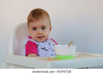 very cute little girl sitting on children's chair