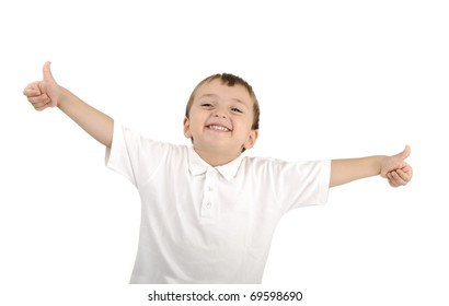 Very cute positive smiling little boy, isolated. Thumbs up, happy succesful winner.