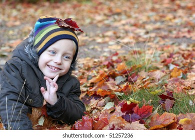 Very very cute smiling 5 years old boy in park